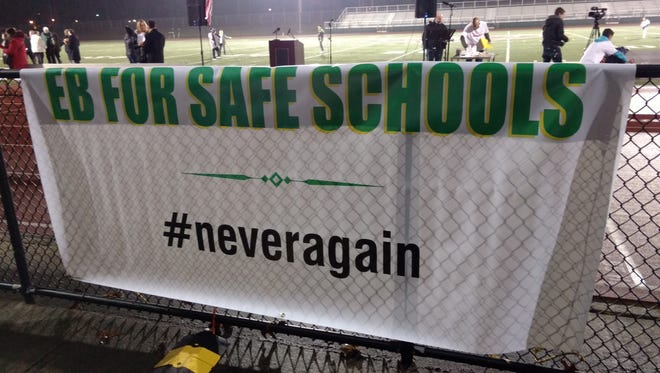 "Nearly 500 parents, students, officials and others gathered at East Brunswick High School in February for the ""Beyond Thoughts and Prayers: #NeverAgain Vigil."""