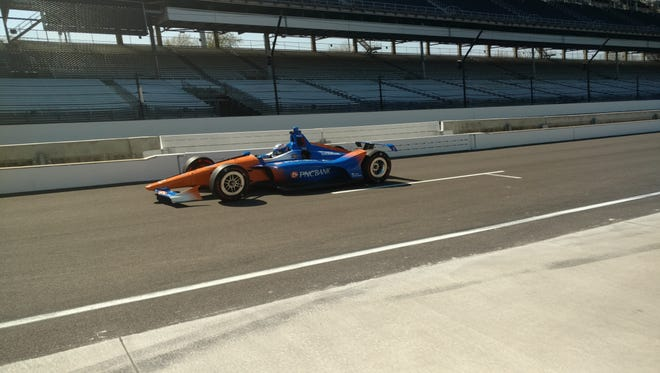 Chip Ganassi Racing driver Scott Dixon exits pit lane during the Verizon IndyCar Series open test Monday at Indianapolis Motor Speedway.