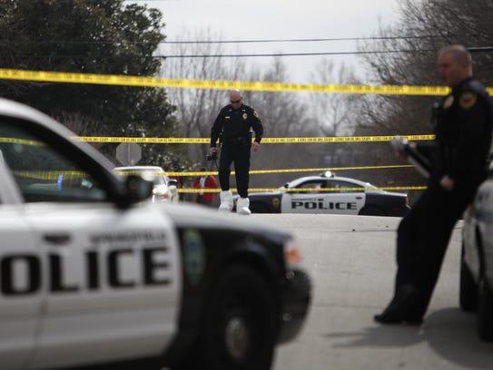 Springfield police investigate the scene of a double