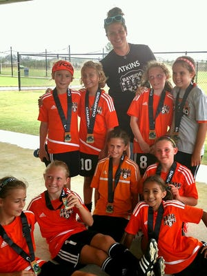 The Bayside 08 youth girls soccer team out of Gulf Breeze won another title last weekend at the Publix Super Cup in Foley, Alabama. Bottom row (L-R): Anna VanBrocklin, Avril Clark, Issabella Powell, Juliet Drost, Madelyn Todorovich. Top row (L-R): Hannah Freeman, Carrie Essary, Vera Custred, Adyson Davidson and coach Molly Mersereau.