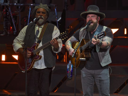 Zac Brown, right, and Darrell Scott perform with the