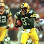 Desmond Howard returns a kick 99 yards for a touchdown  in Super Bowl XXXI.