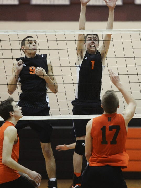 Central York's Jason Gardner, left, and Landon Shorts defend against Northeastern's Reese Devilbiss, right, and Philip White during the boys' volleyball game at Central York High School Thursday, May 8, 2014. Central swept Northeastern for the YAIAA regular season title. Kate Penn -- Daily Record/Sunday News
