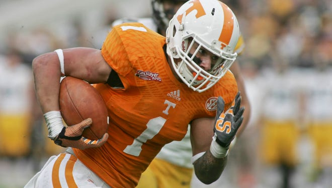Tennessee Volunteers running back Jalen Hurd (1) runs for a 29-yard touchdown in the first quarter of their 2015 TaxSlayer Bowl against the Iowa Hawkeyes at EverBank Field.