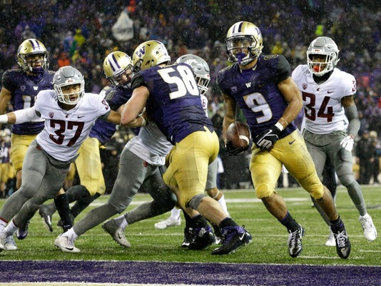 Washington running back Myles Gaskin (9) rushes for a touchdown against Washington State during the second half of an NCAA college football game, Saturday, Nov. 25, 2017, in Seattle. It was Gaskin's fourth touchdown of the game. (AP Photo/Ted S. Warren)