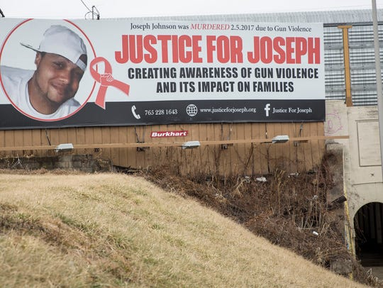 Family and friends of Joseph Johnson stand together