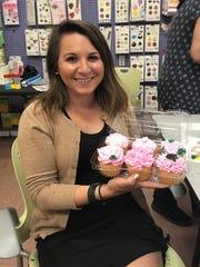 Jenna Intersimone at a Candyland Crafts cupcake decorating class.