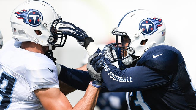 Titans outside linebacker Kevin Dodd (93) tries to get past tight end Jace Amaro (88) during training camp practice Wednesday, Aug. 9, 2017, at Saint Thomas Sports Park.