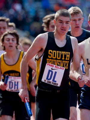 Nick Neville runs a blistering second leg for South Brunswick's 4x800 at the Penn Relays.