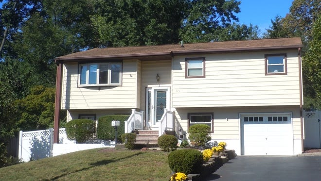 This four-bedroom home has two patios in the fenced backyard, an open floor plan upstairs and an updated kitchen.
