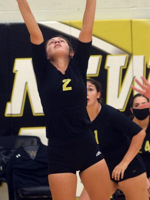 Newton senior Marah Zenner sets the ball during play Saturday at Ravenscroft Gym. Newton plays Tuesday at Maize South with Garden City.