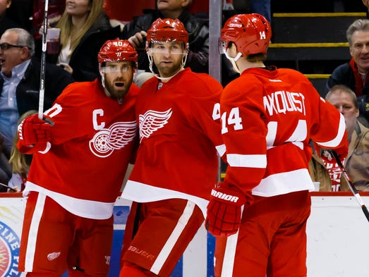 Red Wings left wing Henrik Zetterberg (left) receives