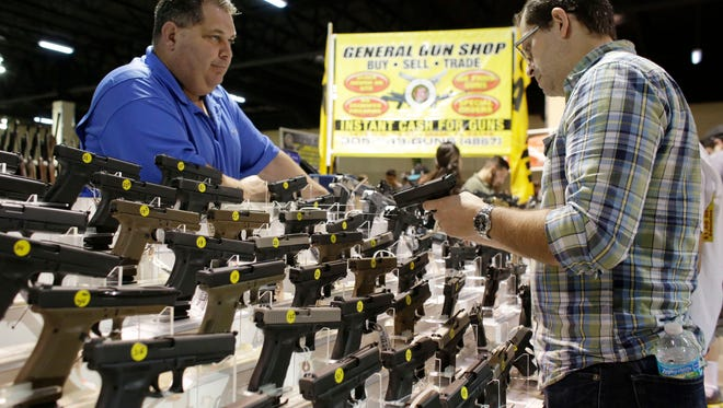 Gun shows, like this one in Miami, offer consumers the chance to purchase a wide variety guns at their leisure.