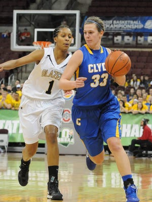 Clyde's Amanda Cahill is pressured by Hathaway Brown's Vanessa Smith during this March 14, 2013 state semifinal game at the Schottenstein Center in Columbus.