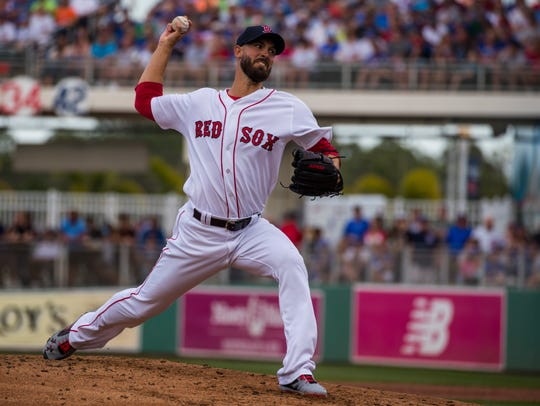 Boston Red Sox pitcher Rick Porcello winds up for a