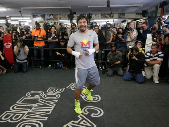 Manny Pacquiao, of the Philippines, shadow-boxes during a media workout at Wild Card Boxing Club on Wednesday in Los Angeles.
