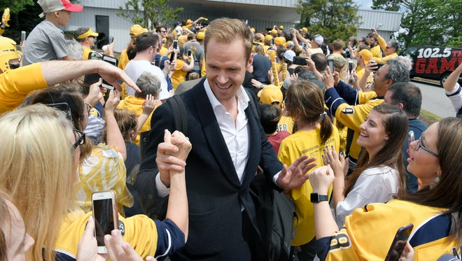 Nashville Predator fans welcome back goalie Pekka Rinne and other players with an airport pep rally in Nashville on Sunday, April 16, 2017.