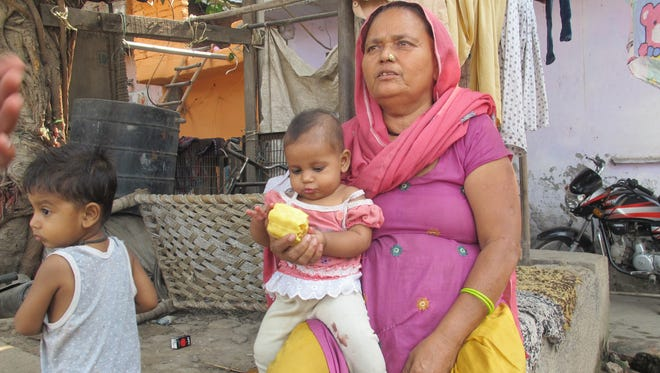 "Outside her home in an east Delhi slum, Chandra Kanta, 62, recalls the day police came to inform her of the death of her son. Mohan Lal, 22, died from asphyxiation while cleaning a government-owned sewage tank, work done almost exclusively by the Dalit castes once called ""untouchables."""