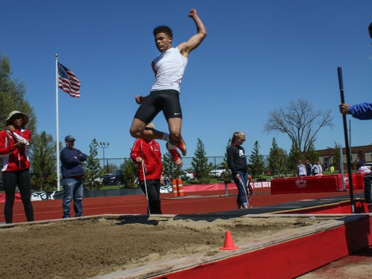 Northeast's Jailyn Ferguson competes in the boys' long