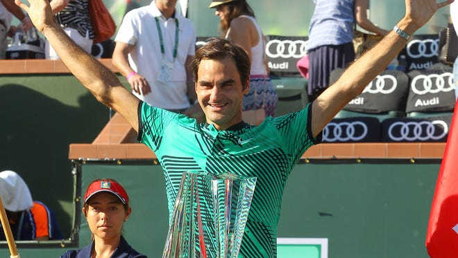 Roger Federer celebrates his win over Stan Wawrinka during the men's finals at the BNP Paribas Open, March 18, 2017.
