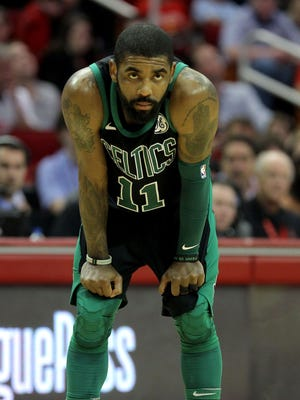 Boston Celtics guard Kyrie Irving looks on against the Houston Rockets during the third quarter at Toyota Center.