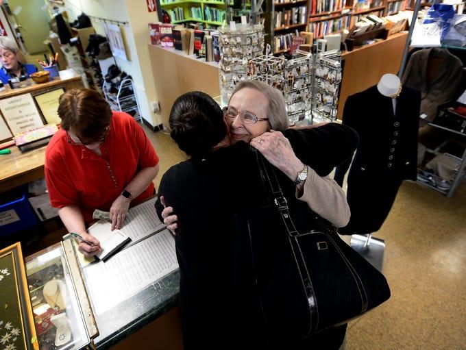 This-n-That Thrift Shop volunteer Bets Ramsey hugs