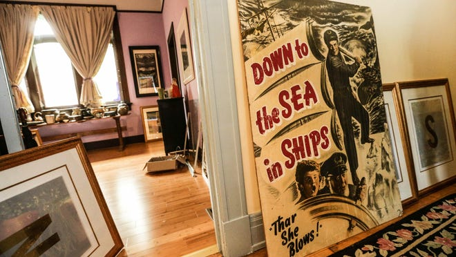 A vintage film poster is up for sale at the former All Souls Unitarian Church, 1455 Alabama St. Tuesday July 7th, 2015. The church is now the home of local artists and educators, Linda Adele Goodine and Mark Richardson. The couple's home and belongings will be part of a three day estate sale, July 17/18/19 from 8:00 AM to 3:00 PM.