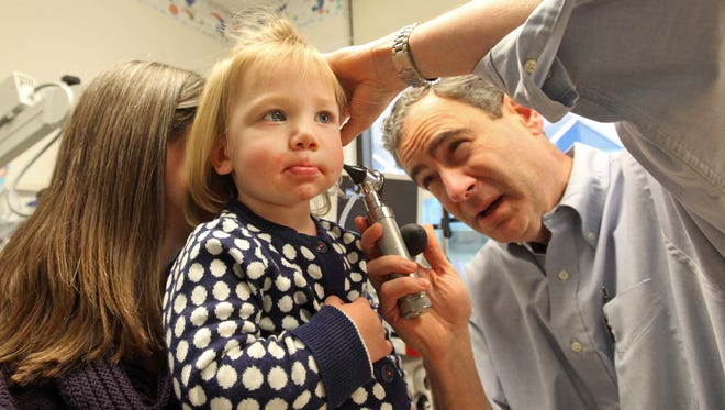 Dr. Robert O'Reilly peers inside Hadley Raffan's ear during check up at A.I. duPont Hospital for Children in 2014. hospital.