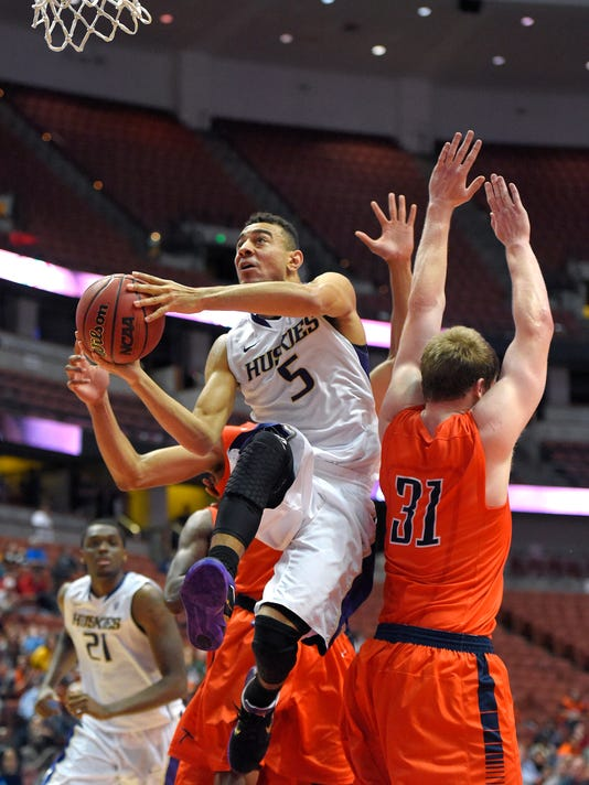 Washington guard Nigel Williams-Goss, left, goes up for a shot as UTEP forward Cedrick Lang defends during the second half an NCAA college basketball game at the the Wooden Legacy tournament, Sunday, Nov. 30, 2014, in Anaheim, Calif. Washington won 68-65. (AP Photo/Mark J. Terrill)