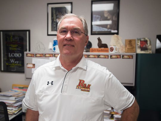 Longtime teacher, coach and athletic director Wayne Moddelmog, shown in his office at Rocky Mountain High School before he retired last summer, received the Keli McGregor Award for servant leadership Wednesday at CHAMP's annual Breakfast of Champions.