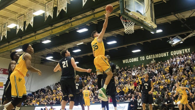 Catamounts forward Payton Henson (35) leaps for a layup during the men's basketball game between the New Hampshire Wildcats and the Vermont Catamounts at Patrick Gym on Thursday night.