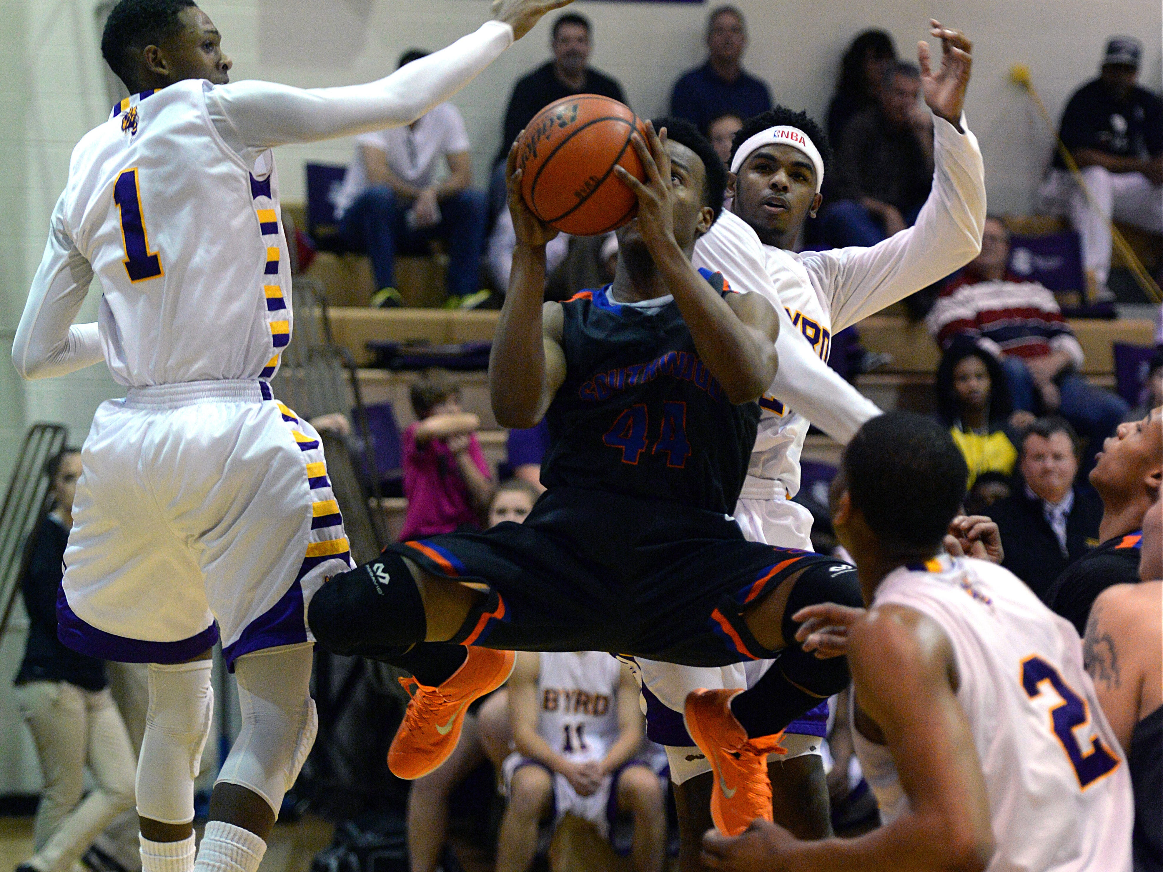 Southwood's Jaylon Payne shotes for two points between a pair of Byrd defenders.
