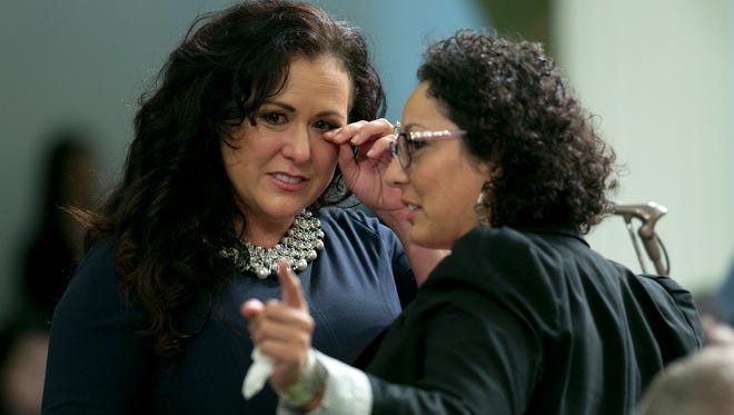 """Assemblywoman Lorena Gonzalez Fletcher, D-San Diego, left, wipes her eyes as she talks with Assemblywoman Cristina Garcia, D-Bell Gardens, during an emotional debate by Assembly members over a """"sanctuary state"""" bill she carried in the Assembly Friday, Sept. 15, 2017, in Sacramento, Calif. The Assembly approved the bill, SB54, by Senate President Pro Tem Kevin de Leon, D-Los Angeles, that would limit police cooperation with federal immigration authorities. It now goes to the Senate for final approval.(AP Photo/Rich Pedroncelli)"""