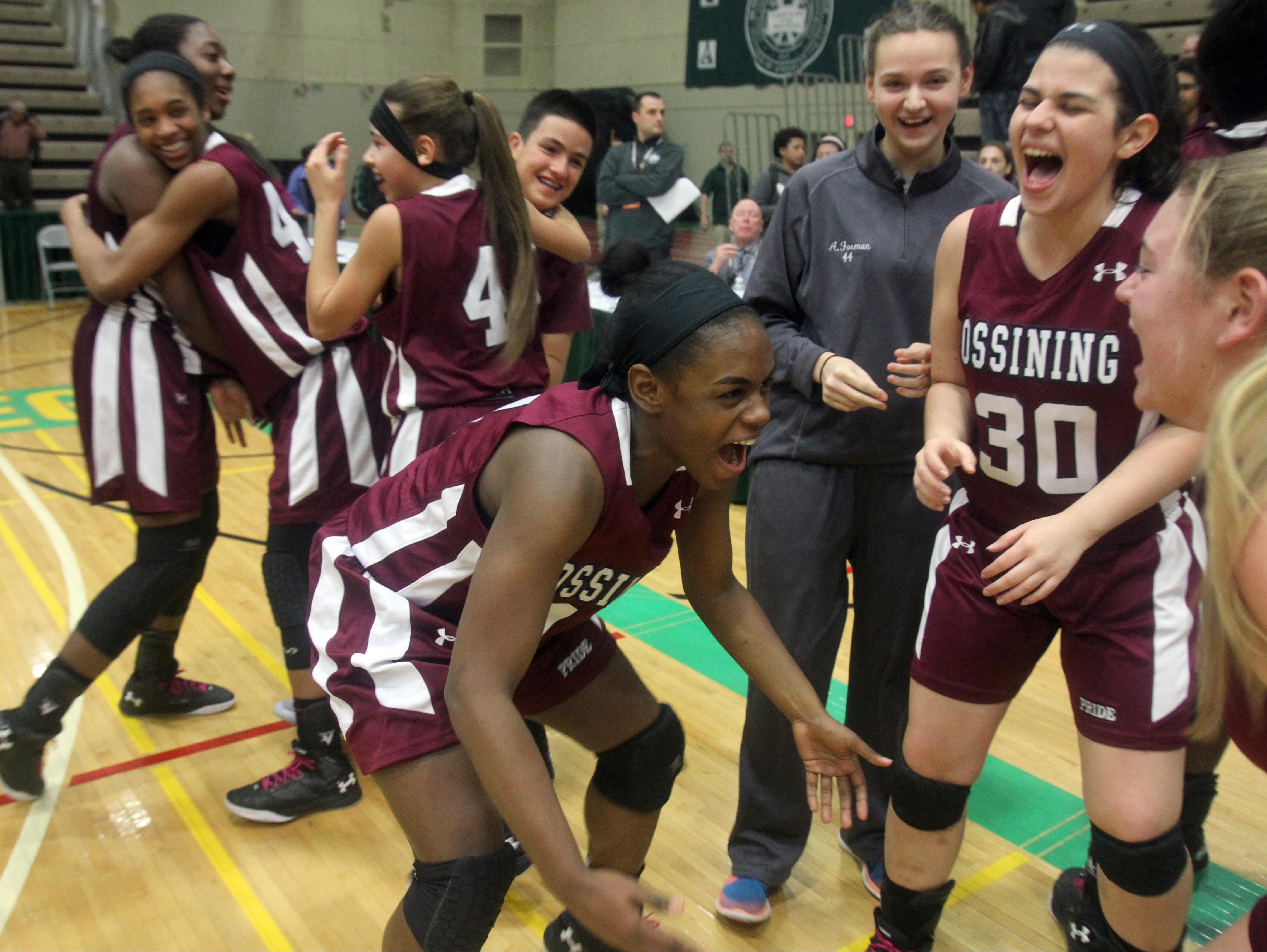 Ossining celebrates after defeating Shenendehowa 69-66 to win the the New York State Class AA championship at Hudson Valley Community College in Troy March 12, 2016.
