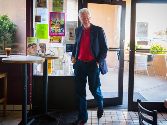 Former United States president Bill Clinton strolls into Cafe Milagro in Las Cruces, NM, to chat with people in the cafe after spending time at Picacho Middle School stumping for his wife, presidential candidate Hillary Clinton, June 2, 2016.