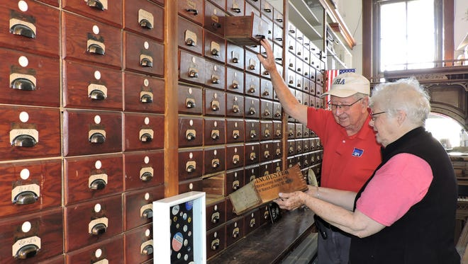 Herb Phillips and wife Helen Phillips volunteer at the Altoona Area Historical Society Cleanup Day this past Saturday. The drawers they're sorting through were built from ammunition boxes and used to store merchandise when the museum's building once housed a hardware store