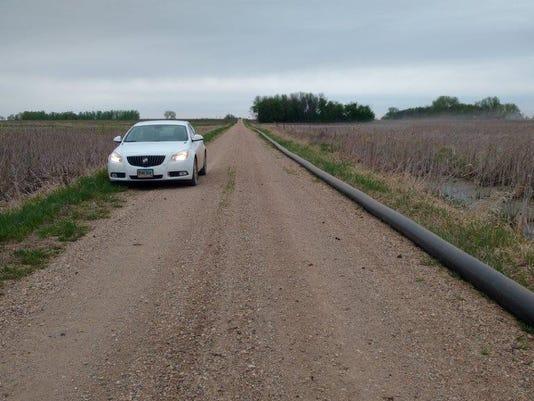 636577409465706766-Manure-pipe-roadside.jpg