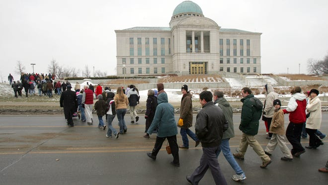 Supporters of a constitutional amendment defining marriage as an institution between one man and one woman walk together to pray at the Iowa Supreme Court building  Jan. 16, 2008.