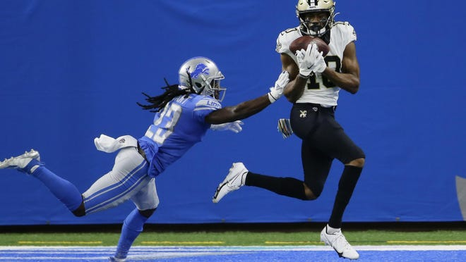 New Orleans Saints wide receiver Tre'Quan Smith, defended by Detroit Lions cornerback Desmond Trufant, catches a 20-yard pass for a touchdown during the first half of an NFL football game, Sunday, Oct. 4, 2020, in Detroit.