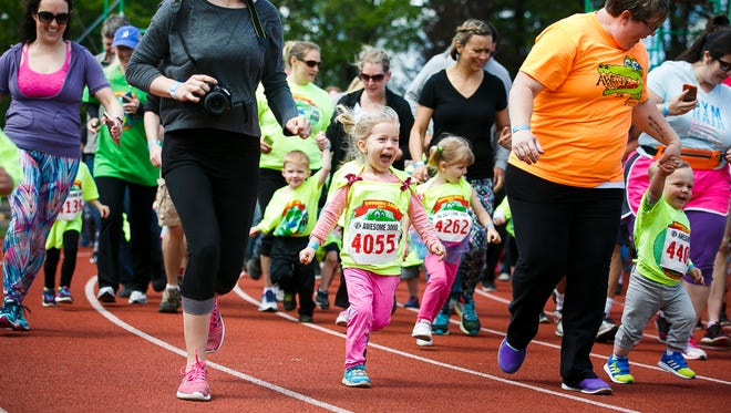 Olivia Brooks takes off from the starting line at the 35th annual Awesome 3000 on Saturday, May 6, 2017, at McCulloch Stadium in Salem, Ore.