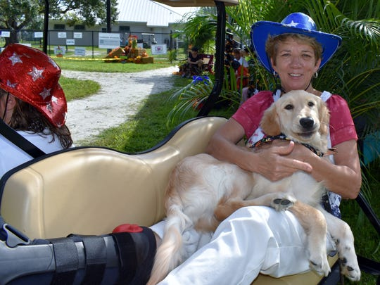 Founder Shelly Ferger was laid up but still made it to the 16th Howl-O-Ween Pawrade.