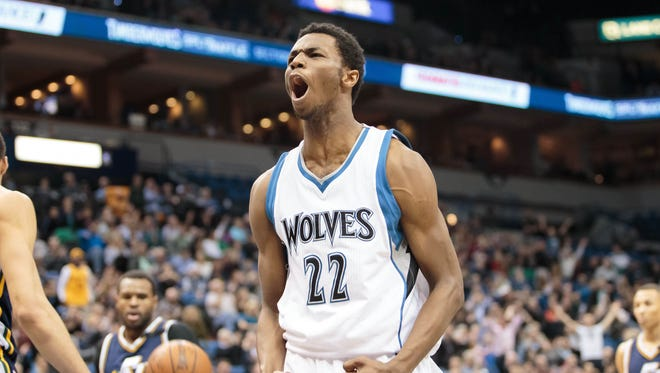 Timberwolves guard Andrew Wiggins celebrates a dunk against the Utah Jazz at Target Center.