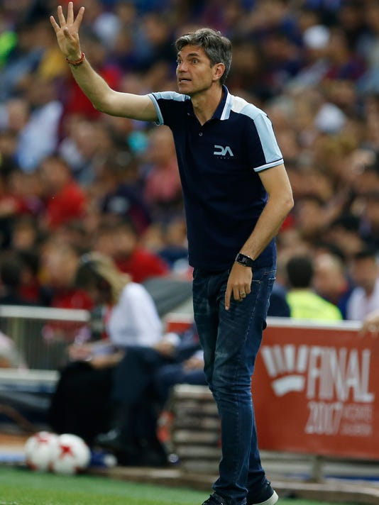 Alaves' coach Mauricio Pellegrino signals during the Copa del Rey final soccer match between Barcelona and Alaves at the Vicente Calderon stadium in Madrid, Spain, Saturday, May 27, 2017. (AP Photo/Francisco Seco)