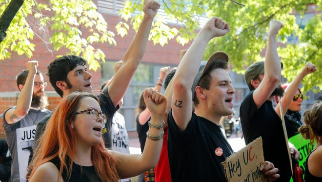 Students engage in a protest on the campus of the University of Cincinnati on June 28, 2017.