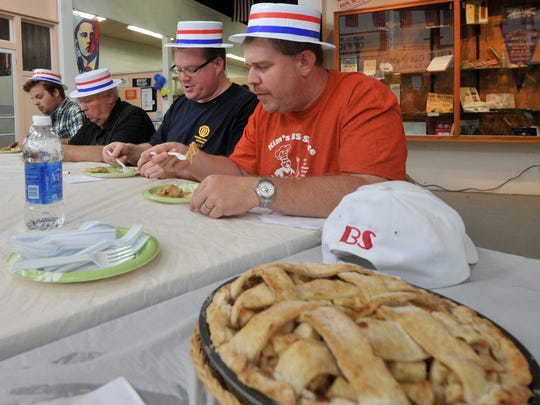 Judges sample all the entries during the pie contest at the 2013 Wisconsin Valley Fair at Marathon Park in Wausau.