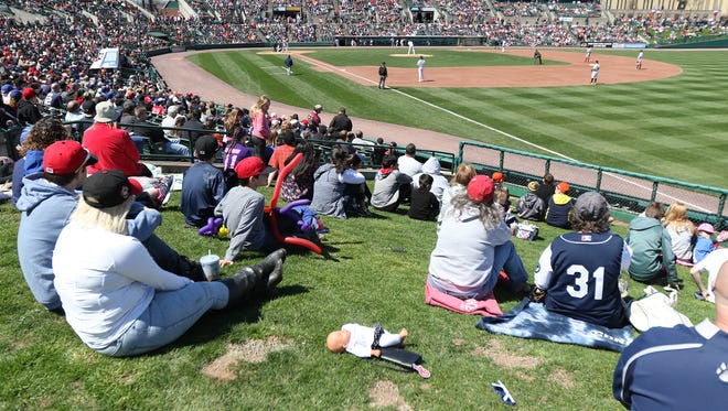 Opening Day for the Rochester Red Wings was a sunny relatively warm day for mid-April in 2017.  Some spectators sat in the grassy area in the outfield.