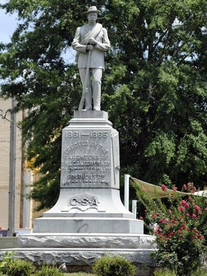 FILE - This Thursday, June 28, 2018 file photo shows a Confederate monument dedicated in 1909 standing in the middle of the square in Tuskegee, Ala.. Following nationwide protests over the police killing of George Floyd and an attack on the monument by vandals, the chairman of the Macon County Commission said officials will cover the memorial with a tarp and are looking for ways to remove it.