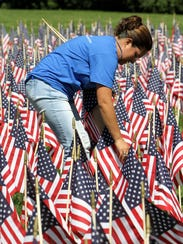 Employees at Armonk-based MBIA installed 2,977 flags
