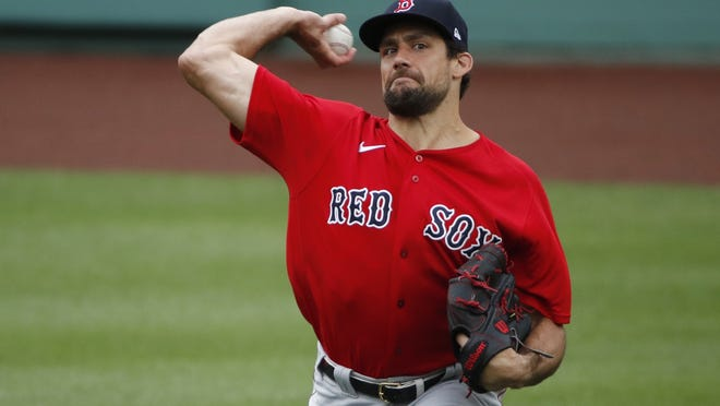 Boston Red Sox pitcher Nathan Eovaldi throws during baseball training camp at Fenway Park, Monday, July 6, 2020, in Boston.