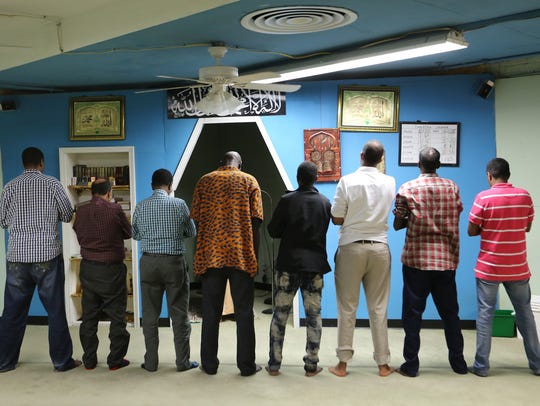Muslim men pryaed in the mosque that is part of the